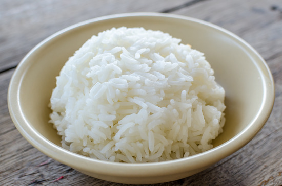 White rice in bowl on the wooden table